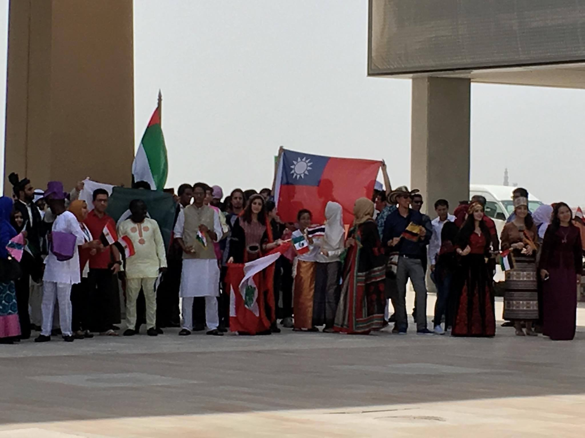 Group picture of all Participants with different dress and flag in opening ceremony