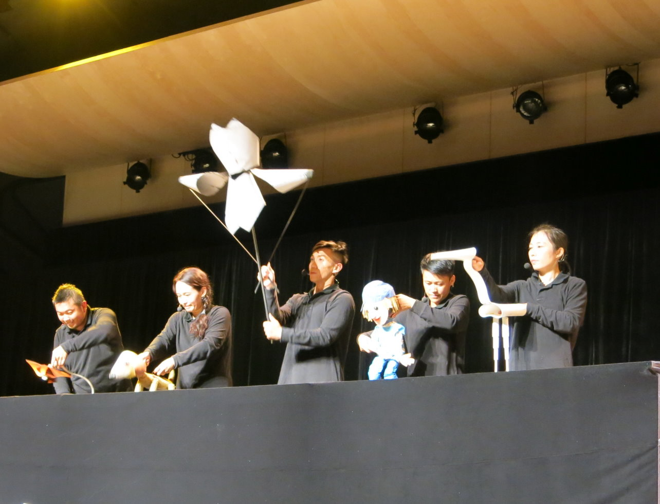 Members of the Puppet Beings Theatre perform a play