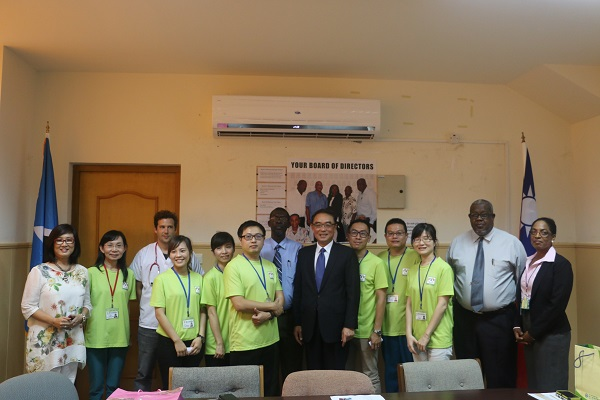 Ambassador Douglas C.T. Shen (middle), Permanent Secretary of Ministry of Health and Wellness, Felix St. Hill (left eight), and CEO of St. Jude Hospital (right one) with Volunteers from Taiwan