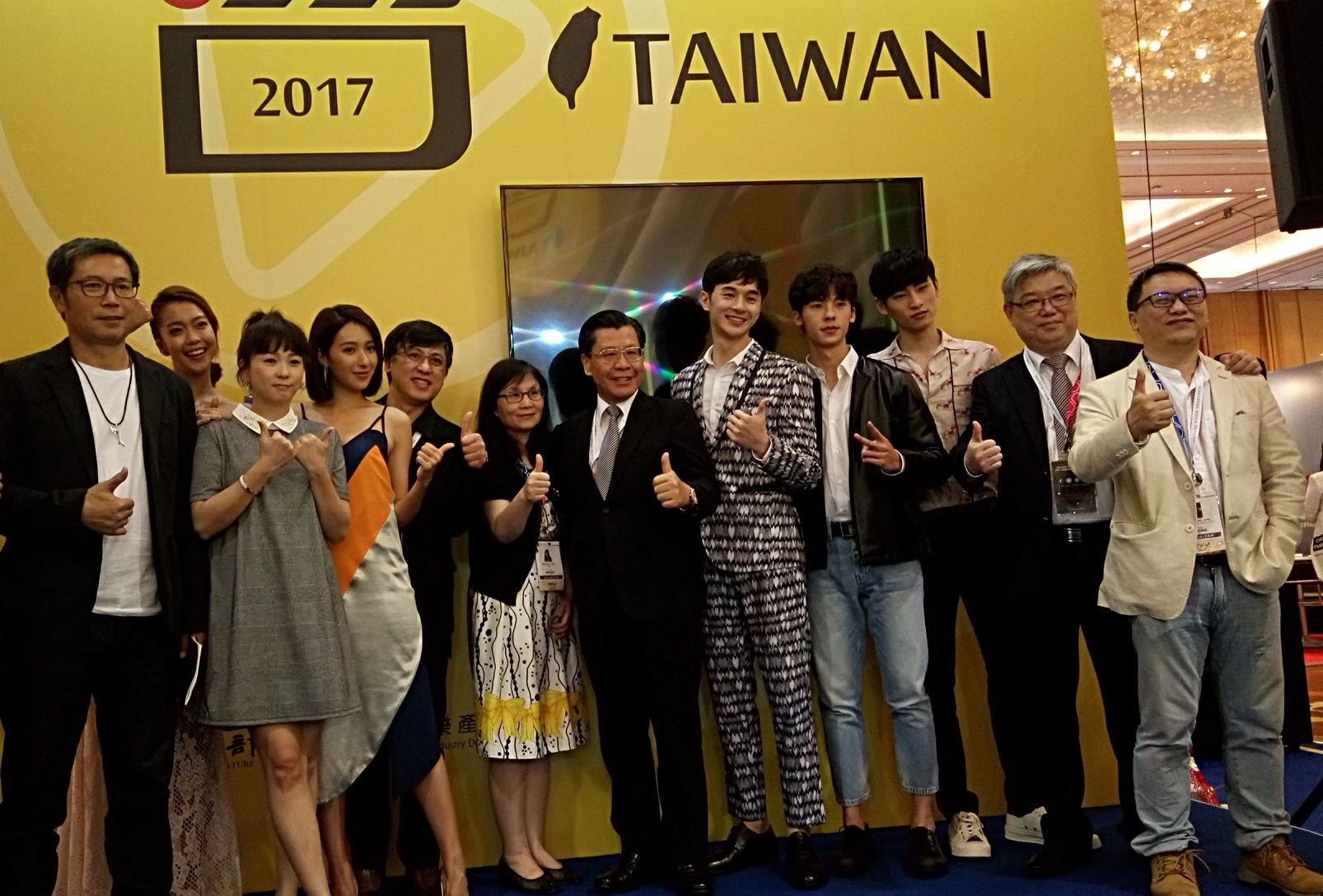 Representative Liang (sixth from right), Director Chen (sixth from left) of Broadcasting Affairs Division of the ROC Bureau of Audiovisual and Music Industry Development, and participants at the ATF