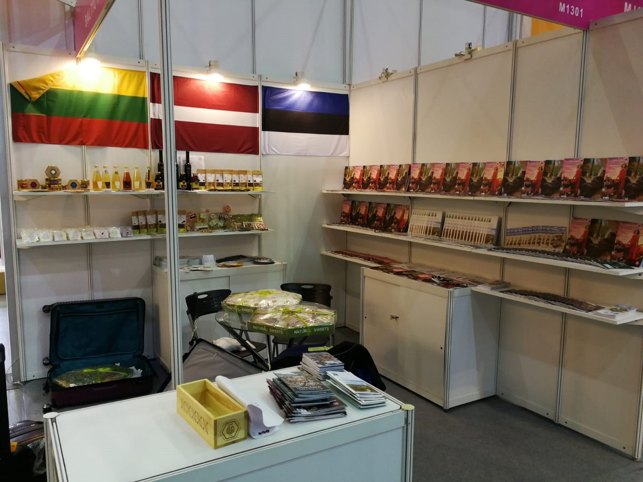 Food product samples and brochures from the Baltics are displayed in the pavilion